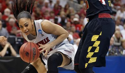 Louisville guard Bria Smith (21) drives against Maryland forward Alyssa Thomas (25)  during the first half of a regional final in the NCAA women's college basketball tournament, Tuesday, April 1, 2014, in Louisville, Ky. (AP Photo/John Bazemore)