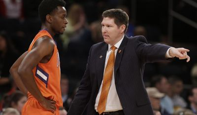 Clemson head coach Brad Brownell talks to Austin Ajukwa during the first half of an NCAA college basketball game against SMU in the semifinals of the NIT Tuesday, April 1, 2014, in New York. (AP Photo/Frank Franklin II)