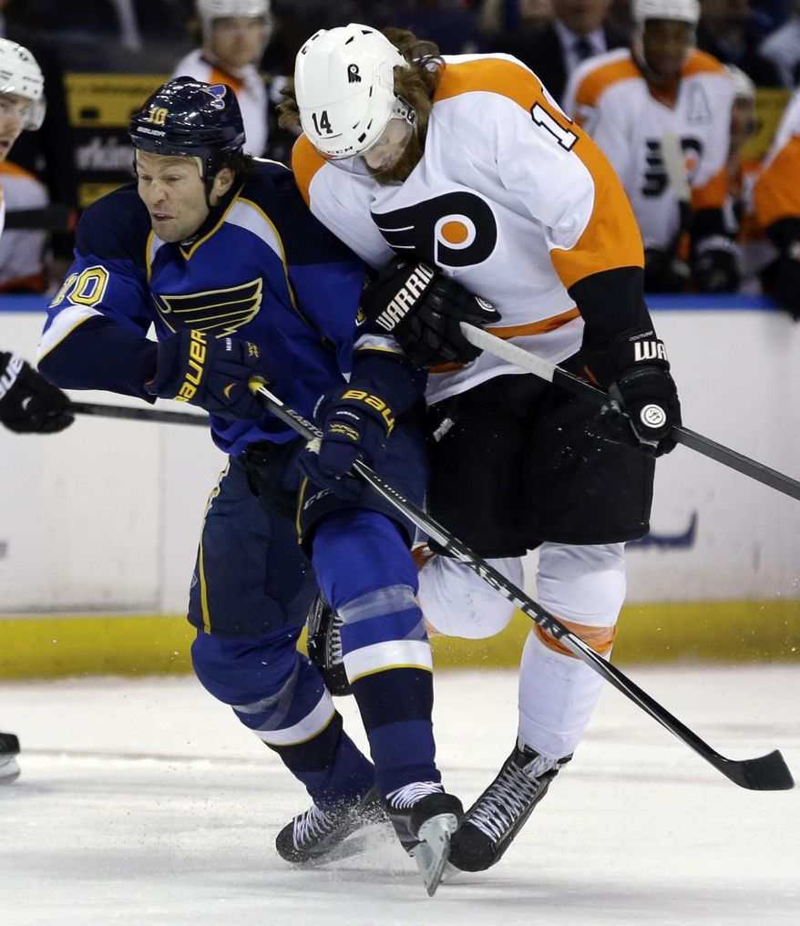 St. Louis Blues' Brenden Morrow, left, and Philadelphia Flyers' Sean Couturier collide during the first period of an NHL hockey game Tuesday, April 1, 2014, in St. Louis. (AP Photo/Jeff Roberson)
