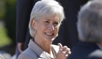 **FILE** Health and Human Services Secretary Kathleen Sebelius sits in the audience as she waits for President Barack Obama to make a statement on the Affordable Care Act on April 1, 2014, in the Rose Garden of the White House. (Associated Press)
