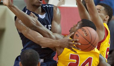 Virginia Military Institute's D.J. Covington (24) and Rodney Glasgow (1) battle for a rebound against Yale's Justin Sears (left) during the second half of an NCAA CIT semi-final college basketball game at Cameron Hall, Tuesday, April 1, 2014, in Lexington, Va. (AP Photo/Don Petersen)