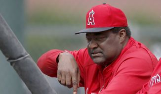 Los Angeles Angels batting coach Don Baylor  talks to a batter during spring training baseball practice on Tuesday, Feb. 25, 2014, in Tempe, Ariz. (AP Photo/Ross D. Franklin)