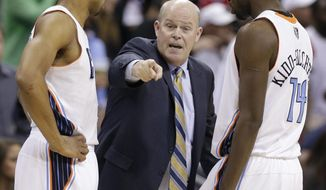 Charlotte Bobcats head coach Steve Clifford, center, talks with Gerald Henderson, left, and Michael Kidd-Gilchrist, right, during the second half of an NBA basketball game against the Washington Wizards in Charlotte, N.C., Monday, March 31, 2014. The Bobcats won 100-94. (AP Photo/Chuck Burton)