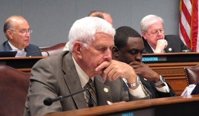 Rep. Rogers Pope, R-Denham Springs, left, and Rep. Ted James, D-Baton Rouge, review Department of Health and Hospitals budget documents on Tuesday, April 1, 2014, in Baton Rouge, La. The House Appropriations Committee raised concerns about Gov. Bobby Jindal's budget proposal for the health department next year. (AP Photo/Melinda Deslatte)