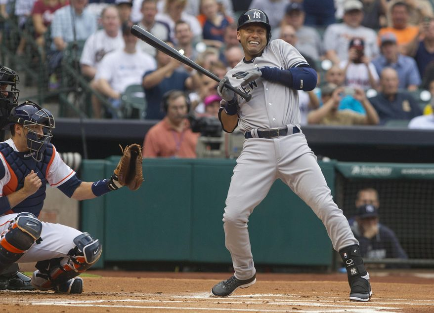 New York Yankees' Derek Jeter reacts after getting hit by a pitch in the first inning against the Houston Astros in a baseball game Tuesday, April 1, 2014, in Houston. The Astros won 6-2. (AP Photo/ The Courier, Jason Fochtman)