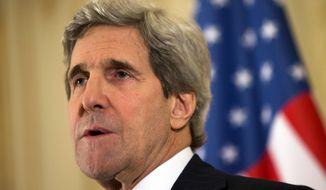 In this March 30, 2014, photo U.S. Secretary of State John Kerry speaks at a news conference in Paris. The United States is talking with Israel about the possibility of releasing convicted spy Jonathan Pollard early from his life sentence as an incentive in the troubled Mideast peace negotiations, a person familiar with the situation said Monday March 31, 2014. (AP Photo/Jacquelyn Martin, Pool)