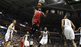 Miami Heat's LeBron James (6) dunks against the Milwaukee Bucks in the first half of an NBA basketball game Saturday, March 29, 2014, in Milwaukee. (AP Photo/Jeffrey Phelps)
