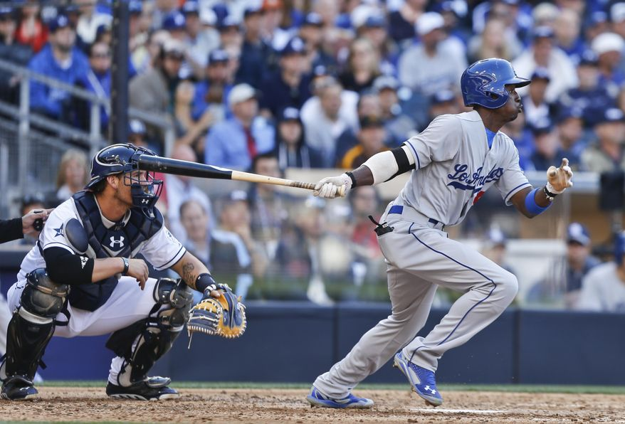 Los Angeles Dodgers' Dee Gordon slaps a base hit to center to drive in a run against the San Diego Padres in the fourth inning of a baseball game Tuesday, April 1, 2014, in San Diego.  (AP Photo/Lenny Ignelzi)