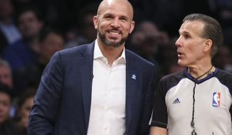 Brooklyn Nets head coach Jason Kidd smiles during the second half of their NBA basketball game against the Houston Rockets at the Barclays Center, Tuesday, April 1, 2014, in New York. (AP Photo/John Minchillo)
