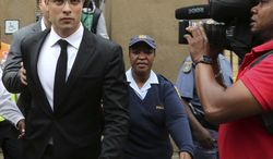 Oscar Pistorius, left, leaves the high court in Pretoria, South Africa, Friday, March 28, 2014. The murder trial of Pistorius has been delayed until April 7 because one of the legal experts who will assist the judge in reaching a verdict is sick, the judge said Friday. Pistorius is charged with murder for the shooting death of his girlfriend, Reeva Steenkamp, on Valentines Day in 2013. Pistorius is charged with murder for the shooting death of his girlfriend, Reeva Steenkamp, on Valentines Day in 2013. (AP Photo/Themba Hadebe)