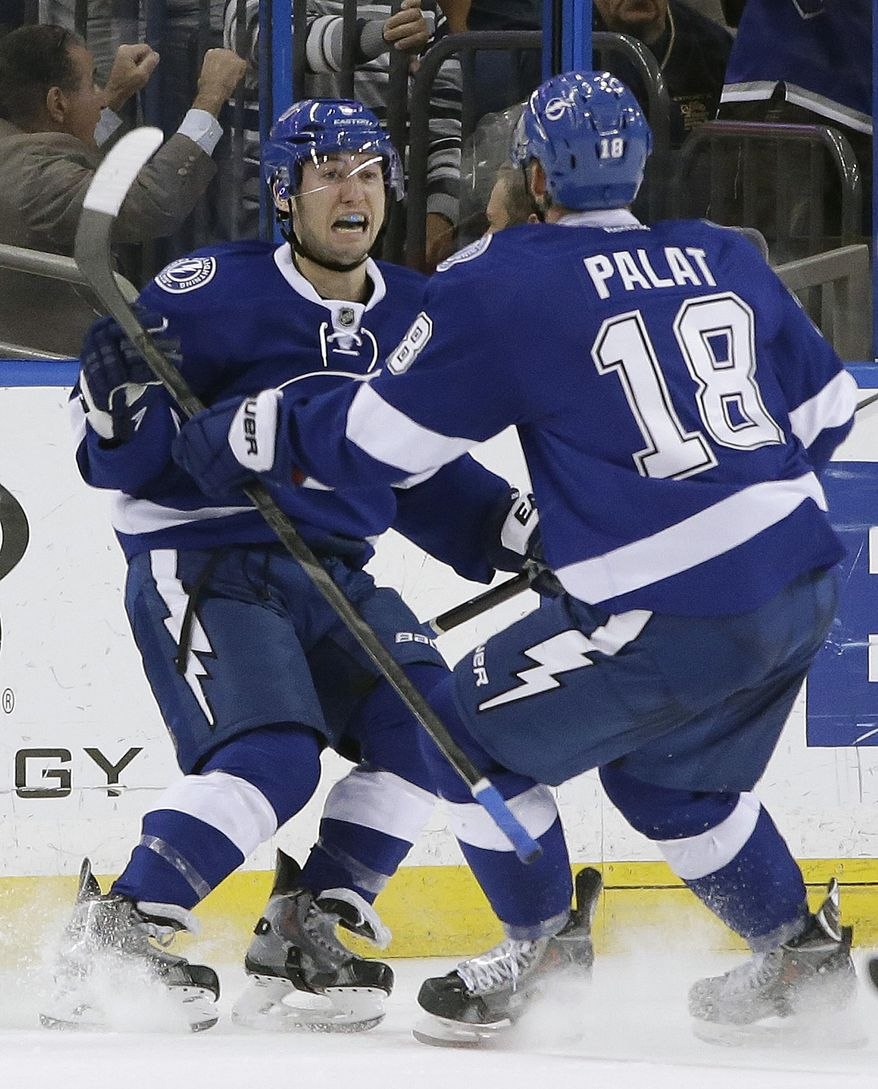 Tampa Bay Lightning center Tyler Johnson celebrates with left wing Ondrej Palat (18), of the Czech Republic, after scoring against the Montreal Canadiens during the third period of an NHL hockey game Tuesday, April 1, 2014, in Tampa, Fla. The Lightning won 3-1. (AP Photo/Chris O'Meara)