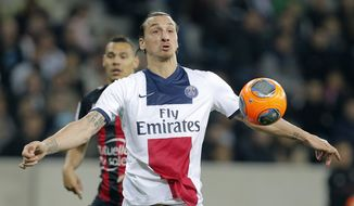 Paris Saint Germain's Zlatan Ibrahimovic of Sweden watches the ball during the French League One soccer match against Nice, in Nice stadium, southeastern France, Friday, March 28, 2014. (AP Photo/Lionel Cironneau)
