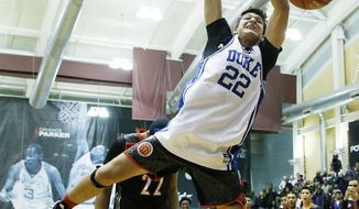 McDonald's West All-American Grayson Allen, of Jacksonville, Fla., competes in the slam dunk contest during the McDonald's All-American Jam Fest at the University of Chicago in Chicago, on Monday, March 31, 2014. Allen won first place in the slam dunk contest. (AP Photo/Andrew A. Nelles)