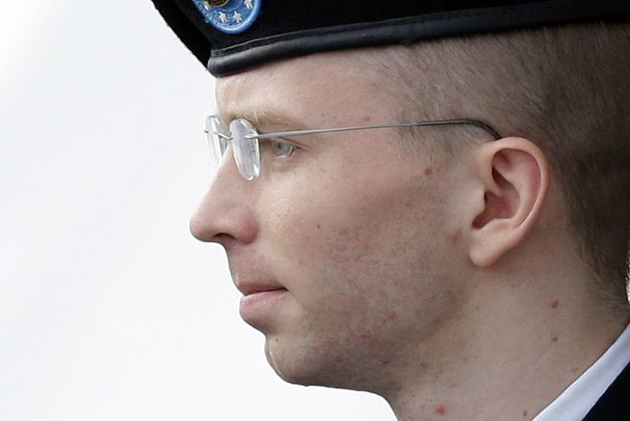 FILE - In this Tuesday, Aug. 20, 2013, file photo, Army Pfc. Bradley Manning, who now wishes to be known as Chelsea Manning, is escorted to a security vehicle outside a courthouse in Fort Meade, Md., after a hearing in his court-martial. The lawyer representing Chelsea Manning in her appeals says the soldier's 35-year sentence for leaking classified information is out of proportion with her offenses. (AP Photo/Patrick Semansky, File)