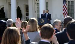President Barack Obama, with Vice President Joe Biden get a standing ovation to make a statement on the Affordable Care Act in the Rose Garden of the White House in Washington, Tuesday, April 1, 2014. (AP Photo/Susan Walsh)