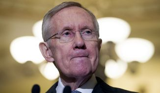 Senate Majority Leader Harry Reid of Nev. pauses as he speaks with reporters on Capitol Hill in Washington, Tuesday, April 1, 2014, following a Senate Policy Luncheon. (AP Photo/Cliff Owen)