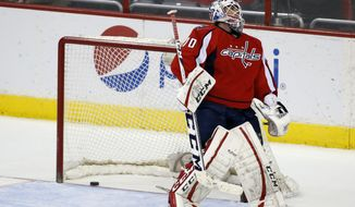 Washington Capitals goalie Braden Holtby reacts after a short-handed goal by Dallas Stars left wing Ryan Garbutt in the third period of an NHL hockey game, Tuesday, April 1, 2014, in Washington. The Stars won 5-0. (AP Photo/Alex Brandon)