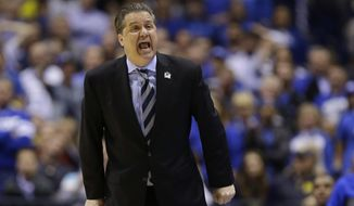Kentucky head coach John Calipari yells during the second half of an NCAA Midwest Regional final college basketball tournament game against Michigan Sunday, March 30, 2014, in Indianapolis. (AP Photo/Michael Conroy)