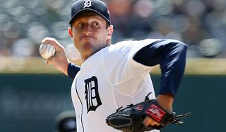 Detroit Tigers pitcher Max Scherzer throws against the Kansas City Royals in the first inning of a baseball game in Detroit Wednesday, April 2, 2014. (AP Photo/Paul Sancya)