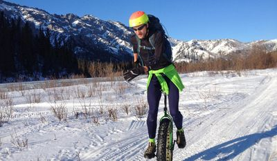 In this photo taken Sunday, March 30, 2014 and provided by Ed Plumb, unicyclist Elliott Wilson leaves a checkpoint during the White Mountains 100-mile ultra-marathon, north of Fairbanks, Alaska. When Wilson decided to ride a unicycle in the White Mountains 100 endurance race, he knew it was an off-the-wall idea. After all, most people wouldn't think about riding 100 miles on snowmachine and dog mushing trails in late March in Fairbanks on two wheels, much less one. Wilson succeeded, much to the surprise of himself, as well as some of Fairbanks' foremost two wheelers. (AP Photo/Ed Plumb)