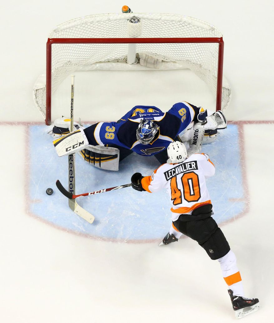 St. Louis Blues goaltender Ryan Miller stops a shot by Philadelphia Flyers center Vincent Lecavalier in a shootout during a game between the St. Louis Blues and the Philadelphia Flyers on Tuesday, April 1, 2014, at the Scottrade Center in St. Louis. (AP Photo/St. Louis Post-Dispatch, Chris Lee)