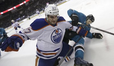 Edmonton Oilers center Boyd Gordon (27) collides with San Jose Sharks defenseman Brad Stuart (7) against the boards during the second period of an NHL hockey game Tuesday, April 1, 2014, in San Jose, Calif. (AP Photo/Tony Avelar)