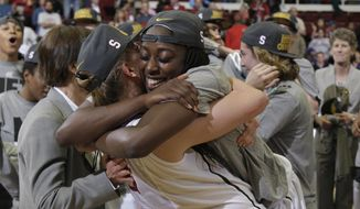 Stanford forward Chiney Ogwumike, front right, hugs forward Mikaela Ruef after Stanford defeated North Carolina 74-65 in a regional final of the NCAA women's college basketball tournament in Stanford, Calif., Tuesday, April 1, 2014. (AP Photo/Marcio Jose Sanchez)