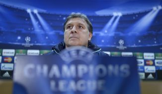 FC Barcelona's coach Gerardo Tata Martino, from Argentina, attends a press conference at the Sports Center FC Barcelona Joan Gamper in San Joan Despi, Spain, Monday, March 31, 2014. FC Barcelona will face Atletico Madrid in a first leg quarter-final Champions League soccer match on Tuesday. (AP Photo/Manu Fernandez)