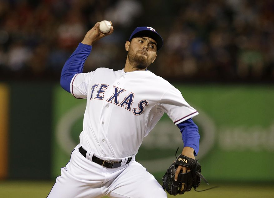 Texas Rangers closer Joakim Soria delivers to the Philadelphia Phillies in the ninth inning of a baseball game, Tuesday, April 1, 2014, in Arlington, Texas. Soria earned the win in the 3-2 Rangers victory. (AP Photo/Tony Gutierrez)