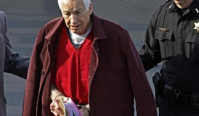 FILE - In this Jan. 10, 2013 file photo, former Penn State University assistant football coach Jerry Sandusky, center, leaves the Centre County Courthouse after attending a post-sentence motion hearing in Bellefonte, Pa. On Wednesday, April 2, 2014, Sandusky lost his bid for the Pennsylvania Supreme Court to review his child molestation conviction, but other legal avenues remain open. (AP Photo/Gene J. Puskar, File)