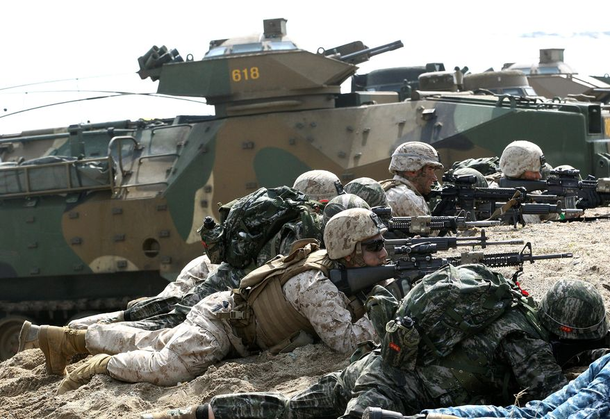 South Korean and U.S. Marines aim their machine guns during the U.S.-South Korea joint landing exercises called Ssangyong, part of the Foal Eagle military exercises, in Pohang, South Korea. (Associated Press)