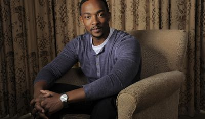 "In this Wednesday, March 12, 2014 photo, Anthony Mackie, a cast member in ""Captain America: The Winter Soldier,"" poses for a portrait in Beverly Hills, Calif.  Mackie plays the role of Falcon in the Marvel/Disney movie which releases on Friday, April 4, 2014. (Photo by Chris Pizzello/Invision/AP)"