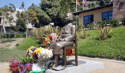 """A bronze statue of a young Korean girl in Central Park in Glendale, Calif. to honor so-called """"comfort women"""" from World War II on Monday, March 31, 2014. Korean-Americans have won approval for local memorials for the victims of Japanese sexual slavery during World War II, over the objections of Japan. They have also pressed states to change school textbooks to address geographical differences with Japan.  (AP Photo/Nick Ut )"""