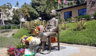 "A bronze statue of a young Korean girl in Central Park in Glendale, Calif. to honor so-called ""comfort women"" from World War II on Monday, March 31, 2014. Korean-Americans have won approval for local memorials for the victims of Japanese sexual slavery during World War II, over the objections of Japan. They have also pressed states to change school textbooks to address geographical differences with Japan.  (AP Photo/Nick Ut )"