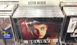 "In this image an album that appears to be Justin Bieber's ""Believe"" sits on the rack at the Best Buy in Culver City, Calif., Tuesday April 1, 2014. Paz, whose full name is Paz Dylan, a 25-year-old electronic musician and artist, says he's planted 5,000 copies of an album that appears to be Bieber's ""Believe"" but that actually contains a copy of his own CD in retailers such as Best Buy, Walmart and Target on April Fool's Day. This album turned out to be a copy of Paz's own CD. (AP Photo/Derrik J. Lang)"