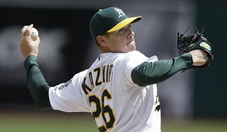 Oakland Athletics' Scott Kazmir works against the Cleveland Indians in the first inning of a baseball game on Wednesday, April 2, 2014, in Oakland, Calif. (AP Photo/Ben Margot)