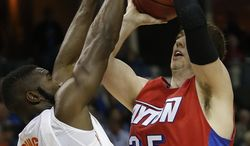 Dayton forward/center Matt Kavanaugh (35) shoots against Florida center Patric Young (4) during the first half in a regional final game at the NCAA college basketball tournament, Saturday, March 29, 2014, in Memphis, Tenn. (AP Photo/John Bazemore)