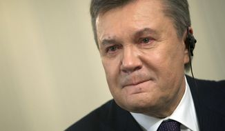 Ousted Ukrainian President Viktor Yanukovych reacts during an interview with The Associated Press, in Rostov-on-Don, Russia, on Wednesday, April 2, 2014. Yanukovych says the annexation of Crimea was a tragedy and he would have done everything possible to prevent it, had he remained in power. (AP Photo/Ivan Sekretarev)