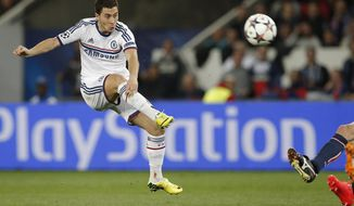 Chelsea's Eden Hazard takes a shot during the Champions League quarterfinal first leg soccer match between PSG and Chelsea, at the Parc des Princes stadium, in Paris, Wednesday, April 2, 2014. (AP Photo/Christophe Ena)