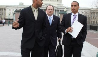 Former Northwestern University football quarterback Kain Colter, right, Ramogi Huma, founder and President of the National College Players Association left, and Tim Waters, Political Director of the United Steel Workers, arrive on Capitol Hill in Washington, Wednesday, April, 2, 2014. Members of a group seeking to unionize college athletes are looking for allies on Capitol Hill as they brace for an appeal of a ruling that said full scholarship athletes at Northwestern University are employees who have the right to form a union. Colter _ the face of a movement to give college athletes the right to unionize _ and Ramogi Huma, the founder and president of the National College Players Association, scheduled meetings Wednesday with lawmakers. (AP Photo/Lauren Victoria Burke)