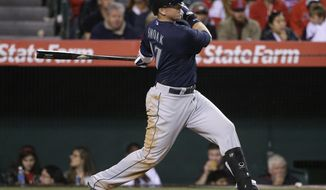 CORRECTS NUMBER OF RBIS TO THREE - SEattle Mariners' Justin Smoak hits a three-RBI double against the Los Angeles Angels during the third inning of a baseball game on Tuesday, April 1, 2014, in Anaheim, Calif. (AP Photo/Jae C. Hong)