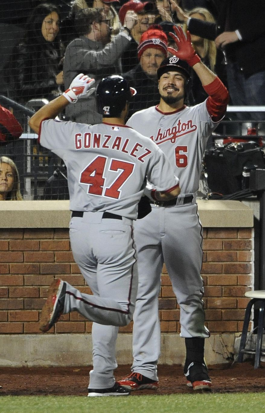 Washington Nationals' Anthony Rendon (6) greets teammate Gio Gonzalez (47) at home plate after Gonzalez hit a solo home run off New York Mets starting pitcher Bartolo Colon in the fifth inning of a baseball game at Citi Field on Wednesday, April 2, 2014, in New York. (AP Photo/Kathy Kmonicek)