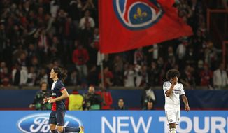 PSG's Edinson Cavani, left, celebrates as Chelsea's Willian reacts after David Luiz scored an own goal during the Champions League quarterfinal first leg soccer match between PSG and Chelsea, at the Parc des Princes stadium, in Paris, Wednesday, April 2, 2014. (AP Photo/Christophe Ena)