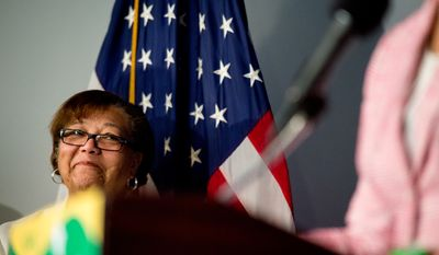 Council Member Anita Bonds (D-At Large) listens as Muriel Bowser speaks at a press conference at the National Press Club after winning the Washington, D.C. mayoral democratic primary, Washington, D.C., Wednesday, April 2, 2014. (Andrew Harnik/The Washington Times)