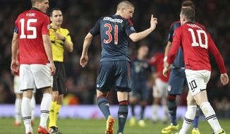 Bayern's Bastian Schweinsteiger, center, argues with Manchester United's Wayne Rooney, after he was sent off the field by referee Carlos Velasco Carballo from Spain, second left, during the Champions League quarterfinal first leg soccer match between Manchester United and Bayern Munich at Old Trafford Stadium, Manchester, England, Tuesday, April 1, 2014.(AP Photo/Jon Super)