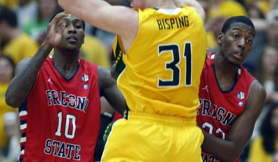 Fresno State defenders Alex Davis (10) and Paul Watson (22) guard Siena's Brett Bisping (31) during the first half of a College Basketball Invitational championship series game Wednesday, April 2, 2014, in Loudonville, N.Y. (AP Photo/Mike Groll)