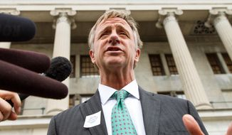 "Gov. Bill Haslam speaks to reporters outside the Capitol in Nashville, Tenn., on Wednesday, April 2, 2014. The Republican governor said making a $300 million incentive package to Volkswagen subject to labor talks concluding to the state's satisfaction was not a threat but a ""statement of reality."" (AP Photo/Erik Schelzig)"