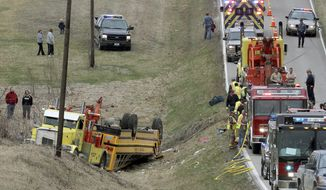 Emergency response personnel work at the scene of an overturned school bus near the rural northeast Missouri town of Ewing near the Illinois border, Tuesday, April 1, 2014. Nearly two dozen students were injured who attended Highland Elementary and Highland High schools in the Lewis County C-1 District. Ewing is located about 125 miles northwest of St. Louis. (AP Photo/Quincy Herald Whig, Steve Bohnstedt)