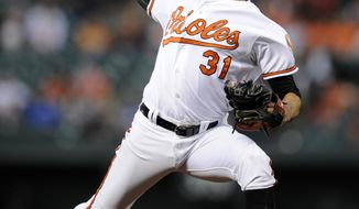 Baltimore Orioles starting pitcher Ubaldo Jimenez (31) delivers a pitch during the first inning of a baseball game against the Boston Red Sox, Wednesday, April 2, 2014, in Baltimore. (AP Photo/Nick Wass)