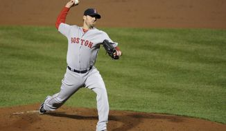 Boston Red Sox starting pitcher John Lackey delivers a pitch during the third inning of a baseball game against the Baltimore Orioles, Wednesday, April 2, 2014, in Baltimore. (AP Photo/Nick Wass)